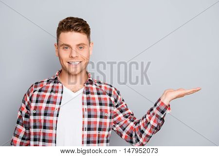 Cheerful Young Man Making Presention Of New Product