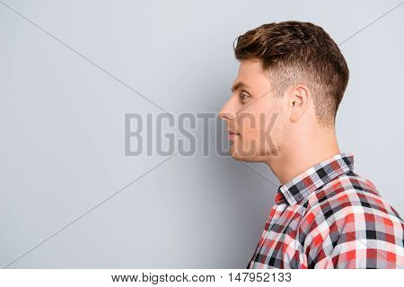 Profile Of Handsome Smiling Young Man On Gray Background