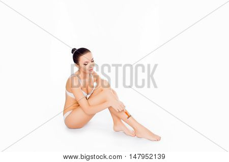 Young Girl In Lingerie  Shaving Her Legs With Razor