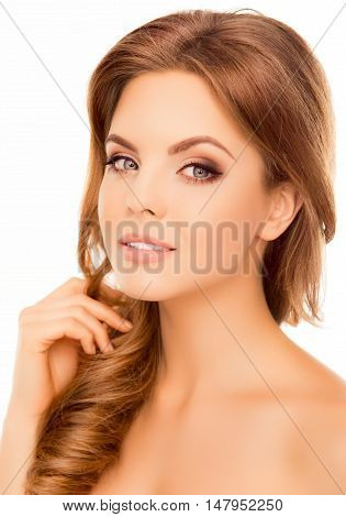 Close Up Of Attractive Woman Touching Her Healthy Hair