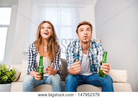 Two Excited Football Fans Drinking Beer And Waiting For Goal