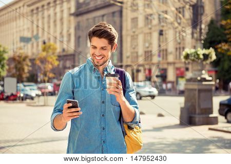 Happy Guy Having Walk In The City And Typing Sms