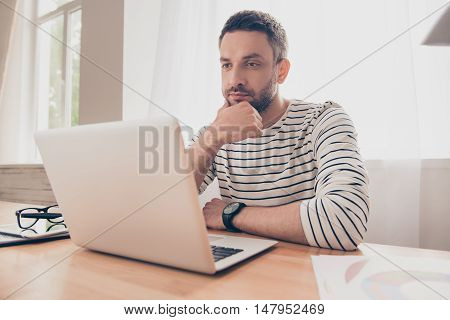 Portrait Of  Serious Man Looking  At Laptop