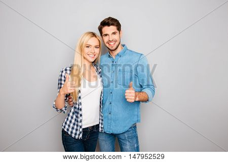 Young Happy Family Huging And Showing Thumb Up