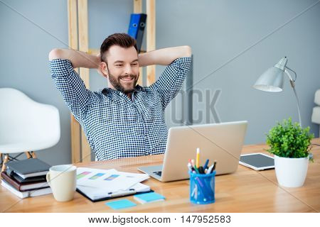 Young Happy Worker Having Break And Resting After Solving Task