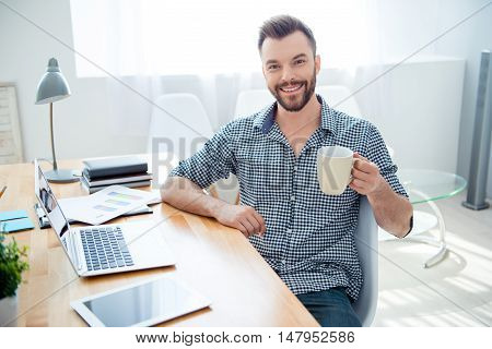 Happy Young Businessman Having Break And Drink Coffee At Workplace