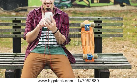 Skateboarding Sitting Relaxation Park Holiday Concept