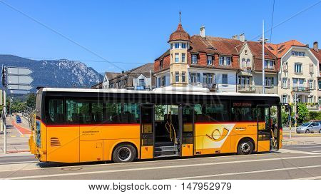 Solothurn, Swizerland - 10 July, 2016: a PostBus on Bahnhofplatz square. PostBus Switzerland (known as PostAuto in German) is a subsidiary company of the Swiss Post, which provides regional and rural bus services throughout Switzerland.