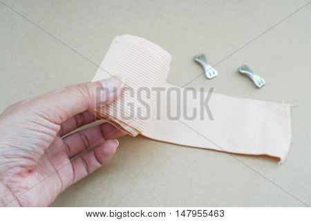 close up unroll a gauze by woman hand