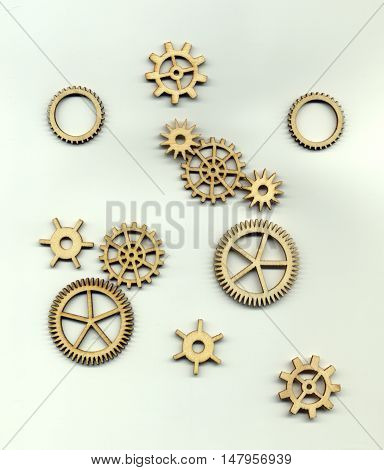 Varieties of different forms of gears on a light background