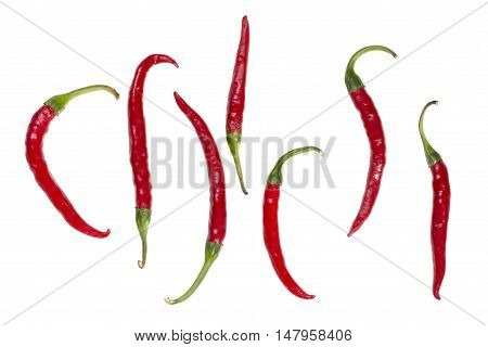 Figure laid out from the fruit of red pepper on a white background