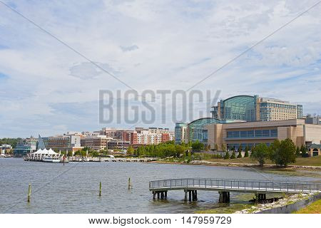 National Harbor waterfront panorama in Oxon Hill Maryland USA. Water transport pier services visitors coming from Washington DC.