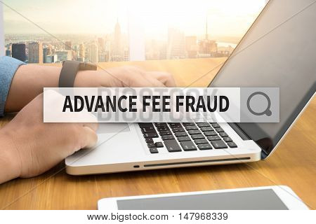ADVANCE-FEE FRAUD SEARCH WEBSITE INTERNET  businessman work hard and use computerSEARCHING