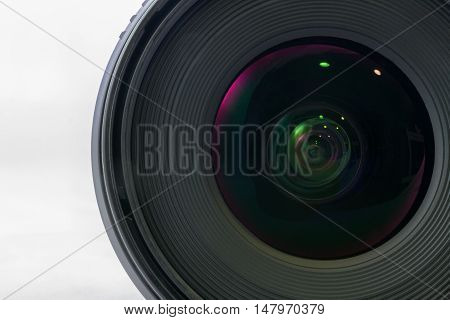 Front view of black camera lens isolated on white background glass side of lens