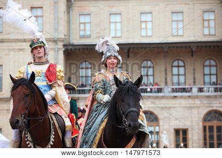 GATCHINA, ST. PETERSBURG, RUSSIA - SEPTEMBER 10, 2016: Actors in image of count Orlov in the Roman costume and countess Sheremeteva in front of Gatchina palace during the festival Gatchinskaya Byl
