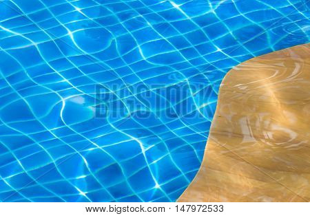 texture of water in swimmingpool with yellow edge pool