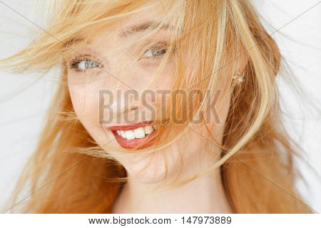 Amazedly smiling red-haired girl portrait. Attractive woman with disheveled hair. Happy morning face portrait