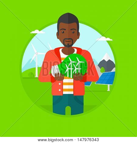 An african-american man holding light bulb with small wind turbines inside on a background with solar pannels and wind turbines. Vector flat design illustration in the circle isolated on background.