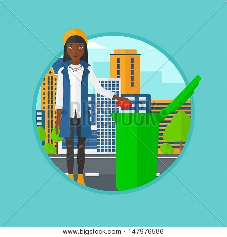 An african-american woman throwing away a garbage in a green bin on a city background. Eco-friendly young woman throwing trash. Vector flat design illustration in the circle isolated on background.