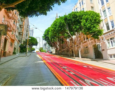 A typical San Francisco street with cable car tracks, California