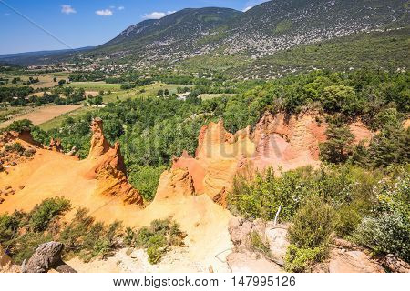 Languedoc - Roussillon, Provence, France. The reserve - pit on production ochre. Orange and red picturesque hills