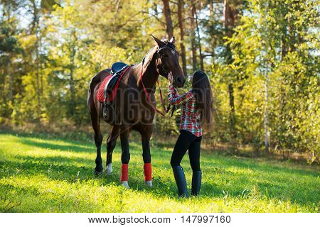 beautiful long hair young woman with a horse outdoor