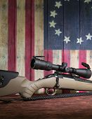 Deer hunting rifle with mid range scope poster