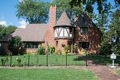 Red Brick English Tudor House with Round Turret poster
