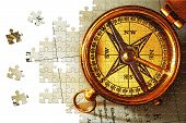 Puzzle Antique brass compass over old Canadian map background poster