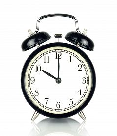 Alarm Clock isolated on white in black and white showing ten o'clock.