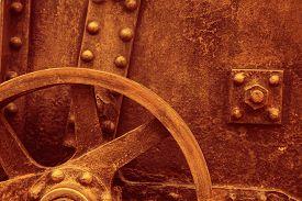 Against the background of the vintage gun. Gun wheel.