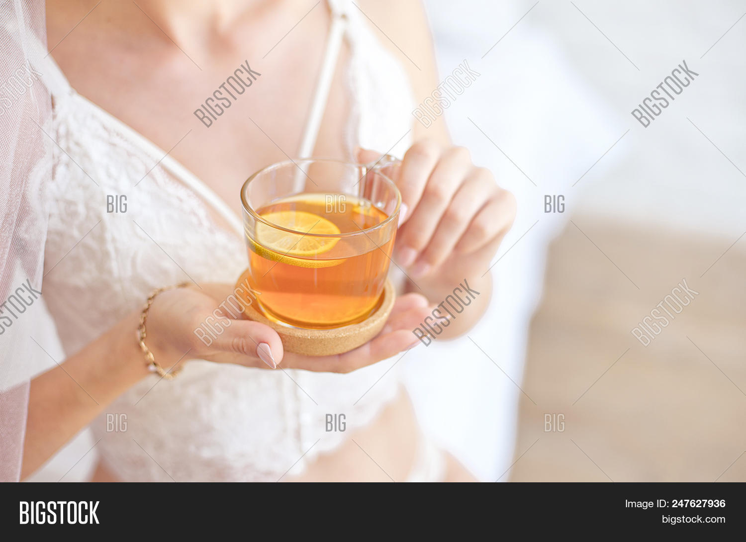 c9a75a740fd Close-up Blonde Bride Drinking Morning Tea In Lingerie And Veil.
