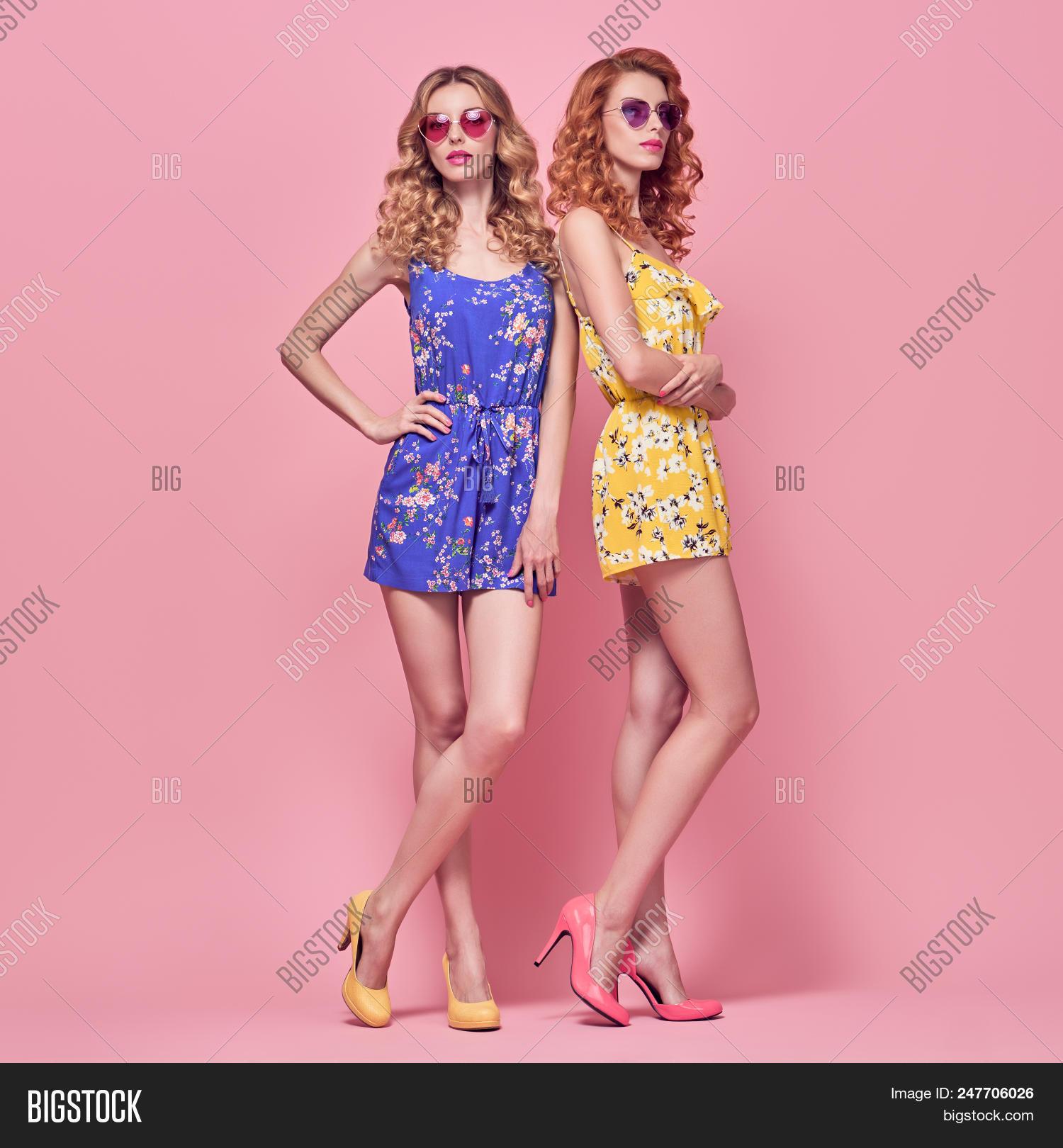 192cf1b88dfb Young Beautiful Playful Girls in Fashion pose. Stylish Outfit