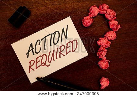 Text sign showing Action Required. Conceptual photo Important Act Needed Immediate Quick Important Task Text white paper note black marker open cap pink crumbled paper question poster