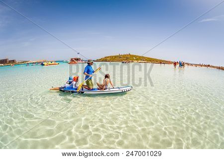 Ayia Napa, Cyprus - April 07, 2018: Father With Kids Having Fun On Stand Up Paddle Board At Nissi Be