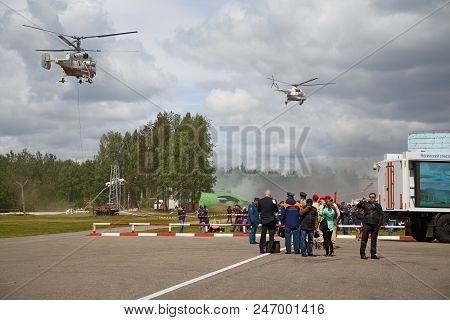 Noginsk, Russia - June 06, 2018. Rescue Helicopters Flying Over The Site Of Noginsk Rescue Center Of