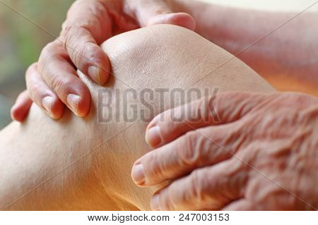 Older Man With An Aching Knee Joint