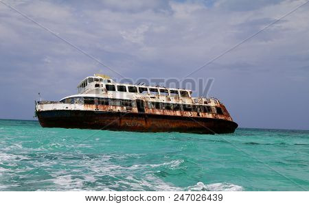 Shipwreck In The Caribbean Rusting In The Ocean