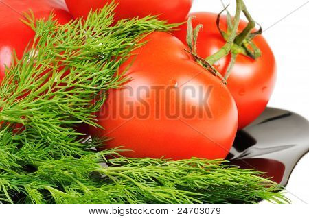 Tomatoes on a black plate