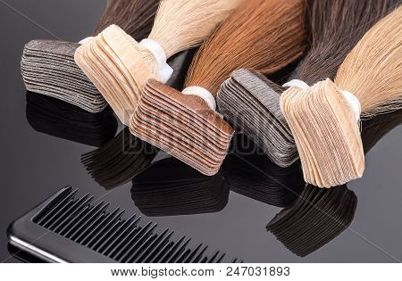 Colored False Hair. Hair For Hair Extension On Black Background.