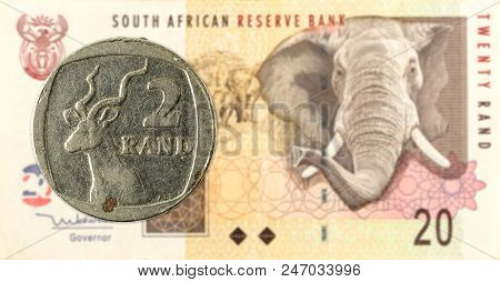 2 South African Rand Coin Against 20 South African Rand Banknote
