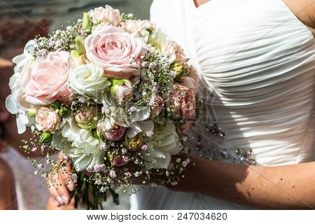 Wedding Bouquet Of Flowers Held By A Bride Closeup. Pink Flower