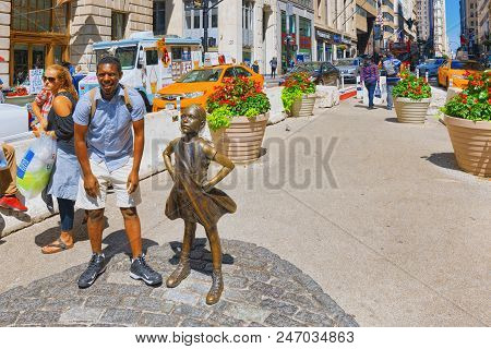 Statue Of Fearless Girl On Broadway. Financial Capital Of America Is New York City.