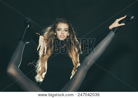 Girls Only Girl Attractive Holds Legs Of Another Woman Black Background. Legs Slim Black Tights And