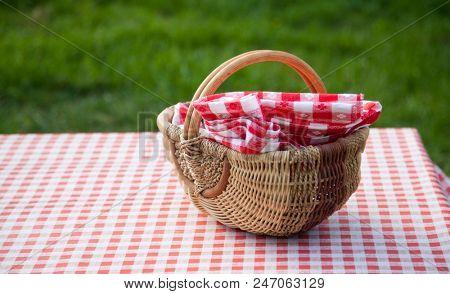 picnic basket on table in the garden - summertime
