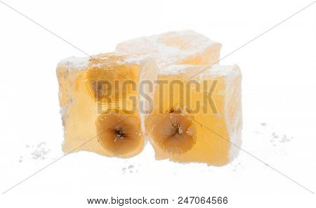 Close-up of traditional Turkish delight isolated on white background.