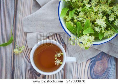 cup of linden tea with fresh linden flowers - alternative medicine