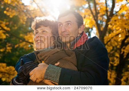elderly couple enjoying peaceful time on autumn day