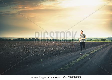 Jogging And Running Outdoors In Nature. Run People Outdoor. Athlete Wearing In Trainers And Leggings