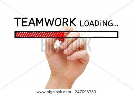 Hand Drawing Teamwork Loading Bar Concept With Marker On Transparent Wipe Board.